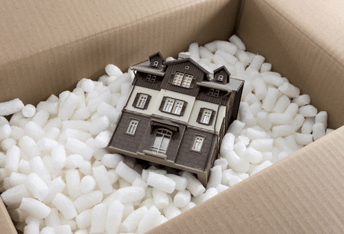 Model house packed in a box with protective material